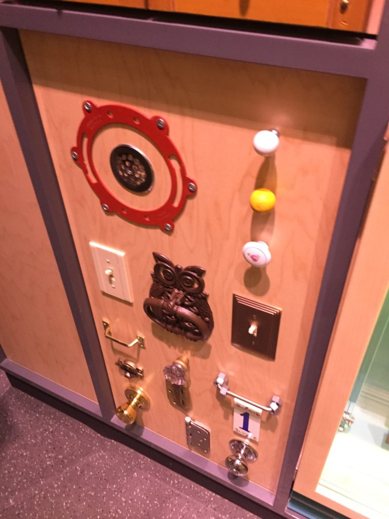 Switches and various door knobs for people to flip and knock.